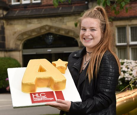 Harrogate Ladies' College pupil with A Star cake