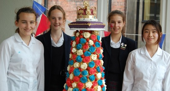 Harrogate Ladies' College pupils with their Queen's 90th Birthday cake