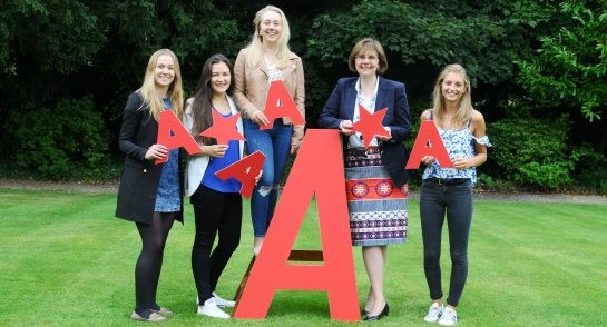 Principal, Sylvia Brett, celebrates an impressive set of A level results with Sixth Form students