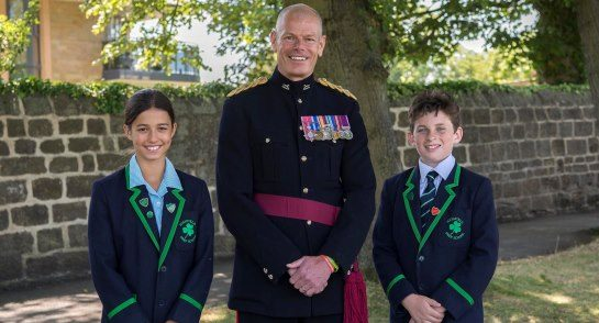 Lt Col Hall with Head Girl Alexa Burrell and Head Boy William Tracy
