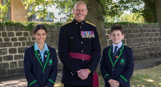 Lt Col Hall with Head Girl Alexa Burrell and Head Boy William Tracy